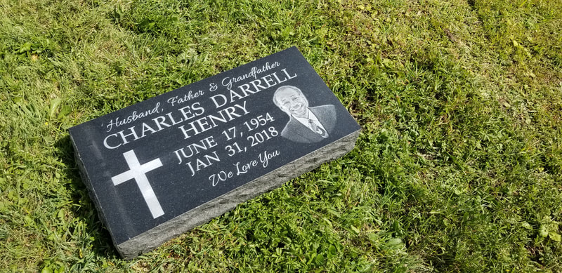 Single Flat Laser Etched Headstone in black granite