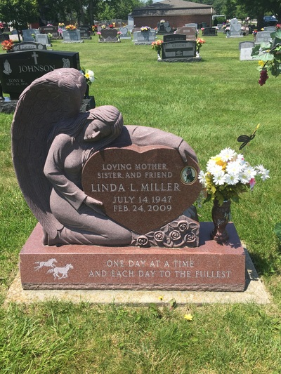 Angel over heart headstone