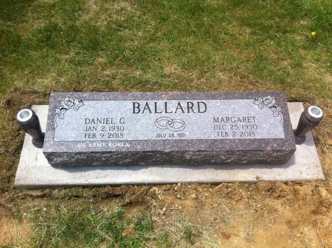 Double flat headstone in mahogany brown granite